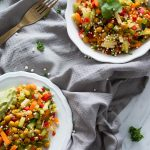 Mixed raw salad with crispy curried chickpeas and creamy avocado dressing