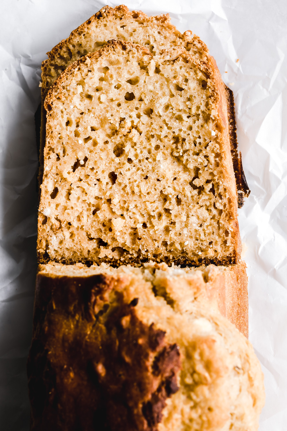sliced applesauce bread on a white paper background