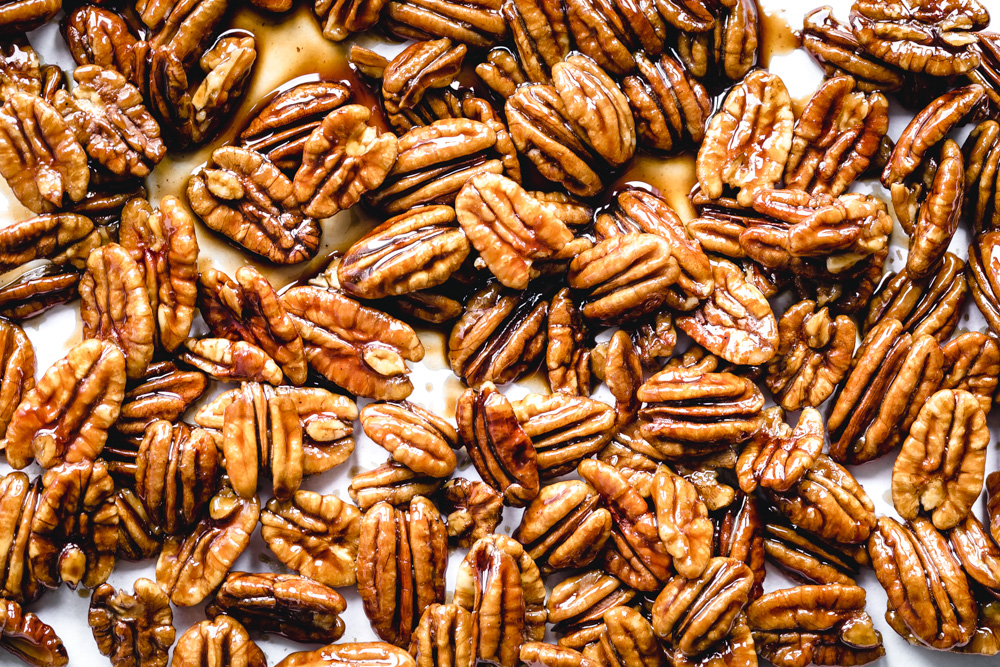coconut sugar glazed pecans on parchment paper