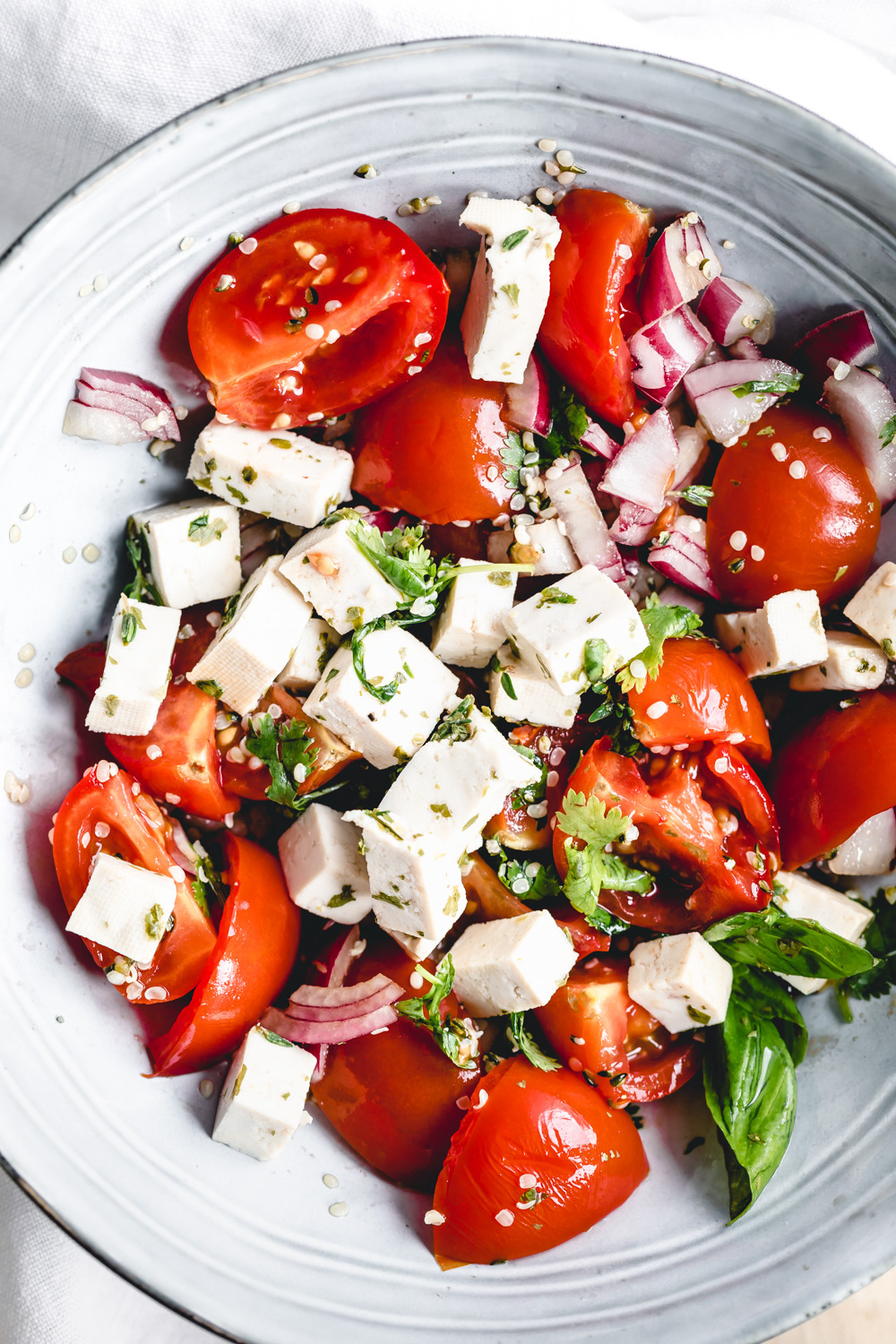 feta cheese in tomato salad close up